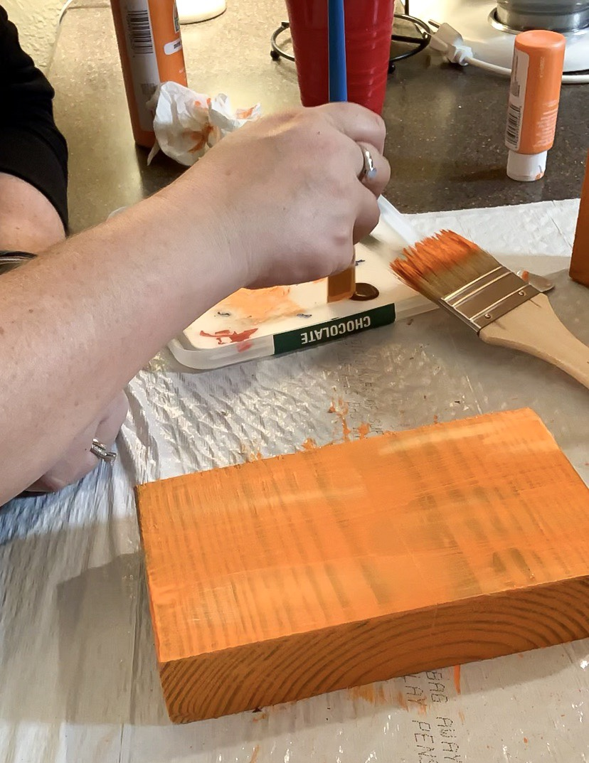 Painting base  wood blocks to look like pumpkins